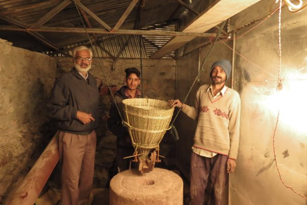 Watermill installed in BMF_ in photo Mr Yogeshwar Kumar (IUCN) with Yoginder Bisht (beneficiary) @IUCN